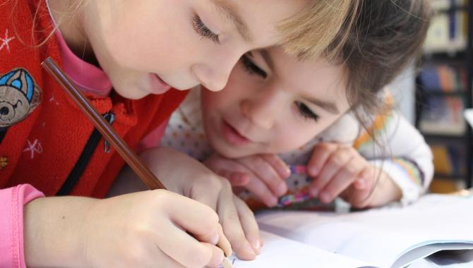 Kids writing with pencil
