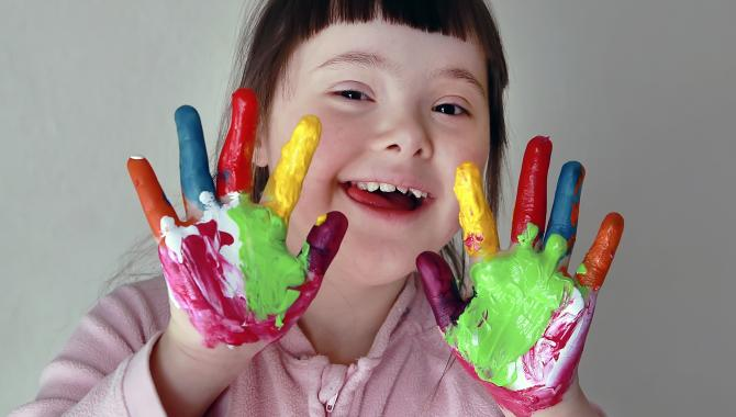 girl with fingers and hands painted