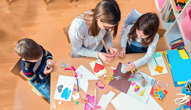 parent and kids working on an art project