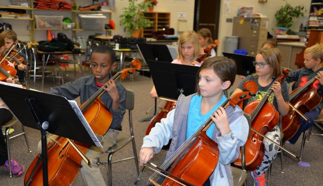 Orchestra students playing cellos