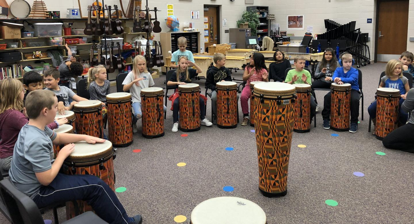students drumming photo
